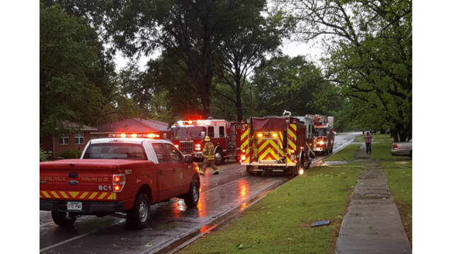 Emergency vehicles on scene of storm damage along South Durant Ave. in Russellville 7_1493227348205.PNG