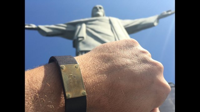 Aaron at Christ Statue with daughters bracelet_1502286628034.jpg