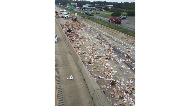 Truck spills hundreds of frozen pizzas, shuts down highway