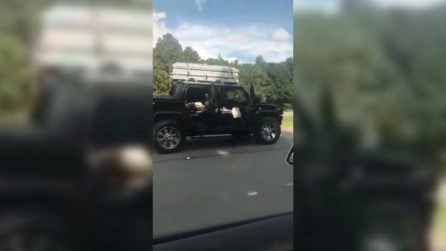Hummer with casket on roof leads police on high speed chase