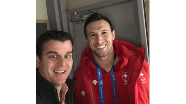 Aaron Nolan with Dominik Maerki of Fayetteville who's competing in curling at the Olympics for his native Switzerland_1519143298945.JPG.jpg